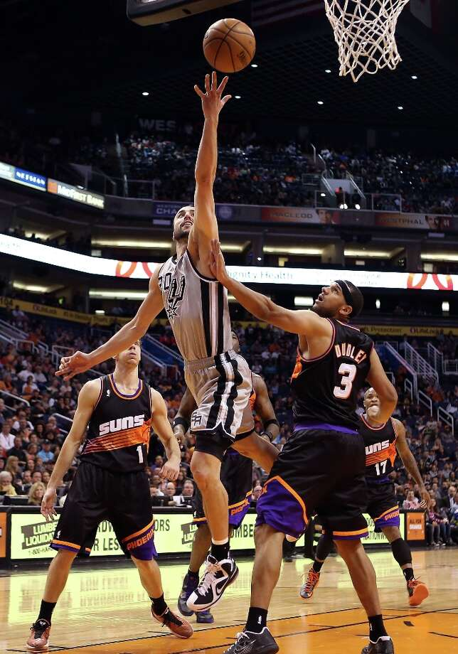 Manu Ginobili #20 of the Spurs lays up a shot past Jared Dudley #3 of the Phoenix Suns during the first half of the NBA game at US Airways Center on February 24, 2013 in Phoenix, Arizona. Photo: Christian Petersen, Getty Images / 2013 Getty Images