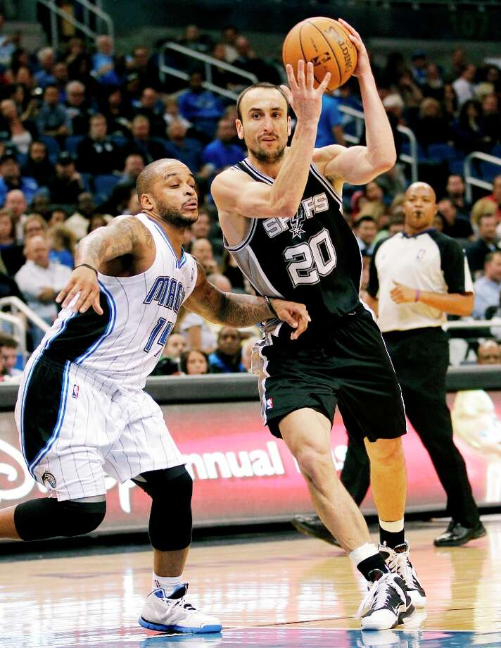 The Spurs' Manu Ginobili (20), of Argentina, drives past Orlando Magic's Jameer Nelson (14) during the second half of an NBA basketball game, Wednesday, Nov. 28, 2012, in Orlando, Fla. The Spurs won 110-89. Photo: John Raoux, Associated Press / AP