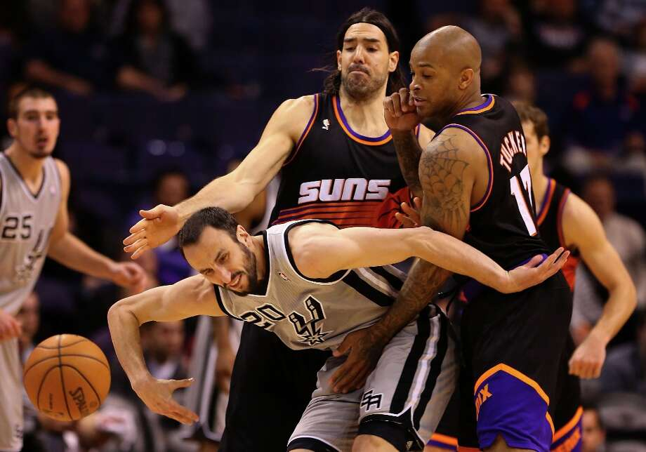Manu Ginobili #20 of the San Antonio Spurs loses the ball guarded by Luis Scola #14 and P.J. Tucker #17 of the Phoenix Suns during the second half of the NBA game at US Airways Center on February 24, 2013 in Phoenix, Arizona.  The Spurs defeated the Suns 97-87. Photo: Christian Petersen, Getty Images / 2013 Getty Images