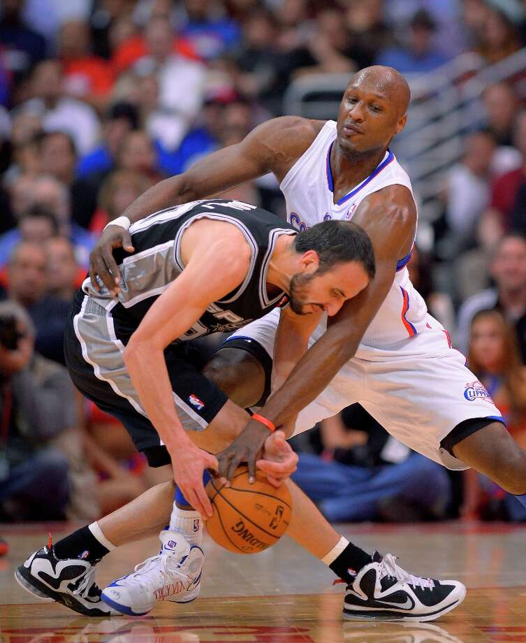 Clippers power forward Lamar Odom, right, ties up San Antonio Spurs guard Manu Ginobili, of Argentina, during the second half of their NBA basketball game, Thursday, Feb. 21, 2013, in Los Angeles. (AP Photo/Mark J. Terrill) Photo: Mark J. Terrill, Associated Press / AP
