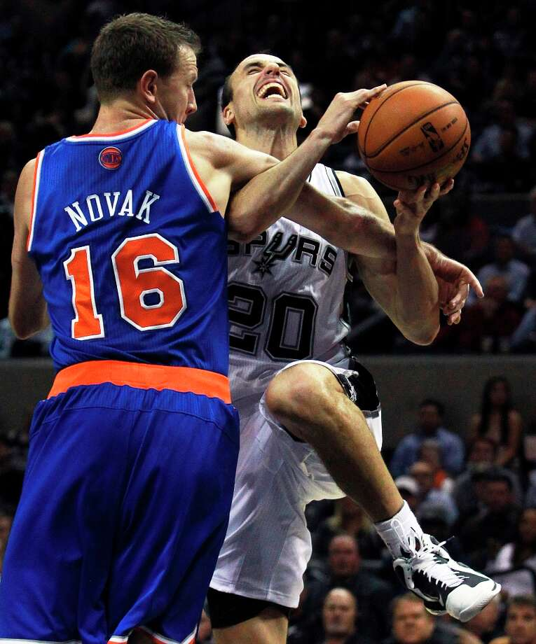 Manu Ginobili gets fouled under the basket by Steve Novak in the second half as San Antonio hosts the New York Knicks at the AT&T Center on November 15, 2012. Photo: Edward A. Ornelas, San Antonio Express-News / ©2012 San Antono Express-News