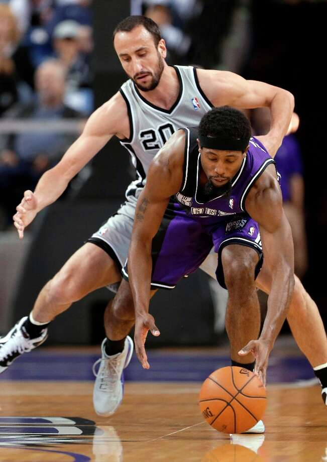 Sacramento Kings forward John Salmons, right, picks up the ball in front of guard Manu Ginobili during the first quarter in Sacramento, Calif., Tuesday, Feb. 19, 2013. Photo: Rich Pedroncelli, Associated Press / AP
