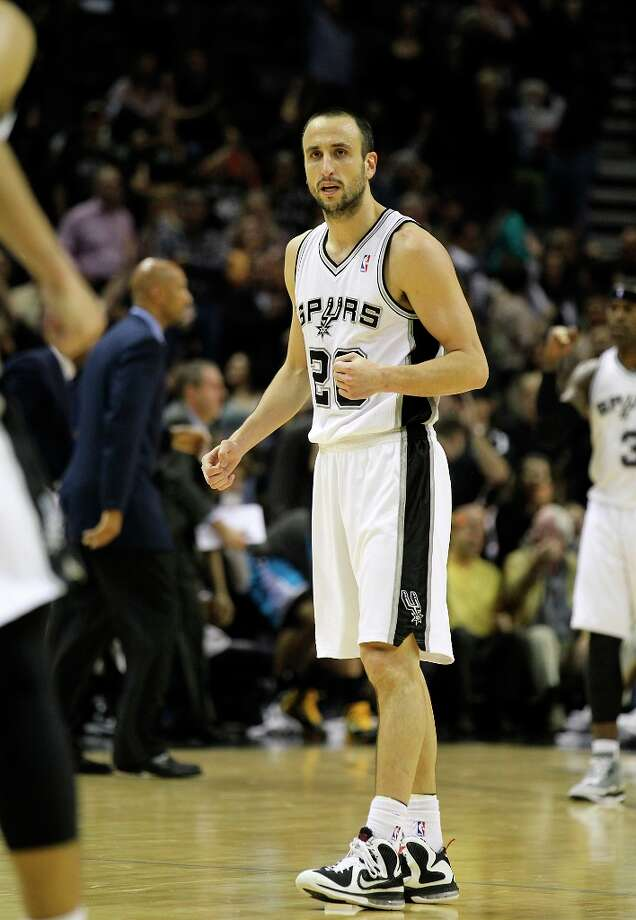 The Spurs' Manu Ginobili (20) reacts after a score against the New Orleans Hornets in the second half on Wednesday, Jan. 23, 2013. Spurs defeated the Hornets, 106-102. Photo: Kin Man Hui, San Antonio Express-News / © 2012 San Antonio Express-News