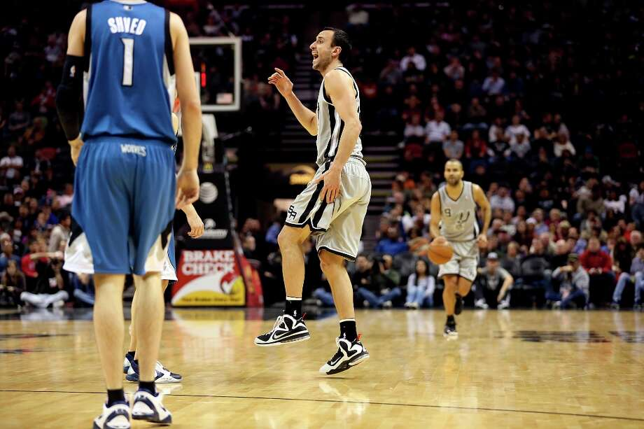 The Spurs' Manu Ginobili yells for a timeout after injuring his left thigh in the first half against the Minnesota Timberwolves at the AT&T Center, Sunday, Jan. 13, 2013. Photo: Jerry Lara, San Antonio Express-News / © 2013 San Antonio Express-News