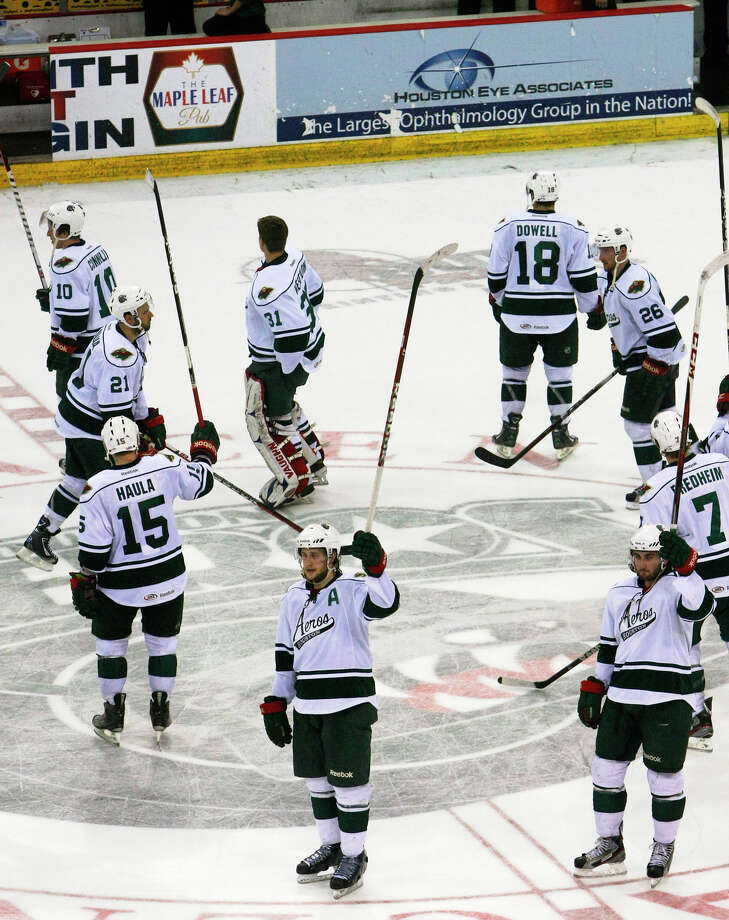 The Houston Aeros celebrate a 4-1 win over the San Antonio Rampage after their final regular-season game at the Toyota Center Saturday, April 13, 2013, in Houston. Photo: Cody Duty, Houston Chronicle / © 2013 Houston Chronicle