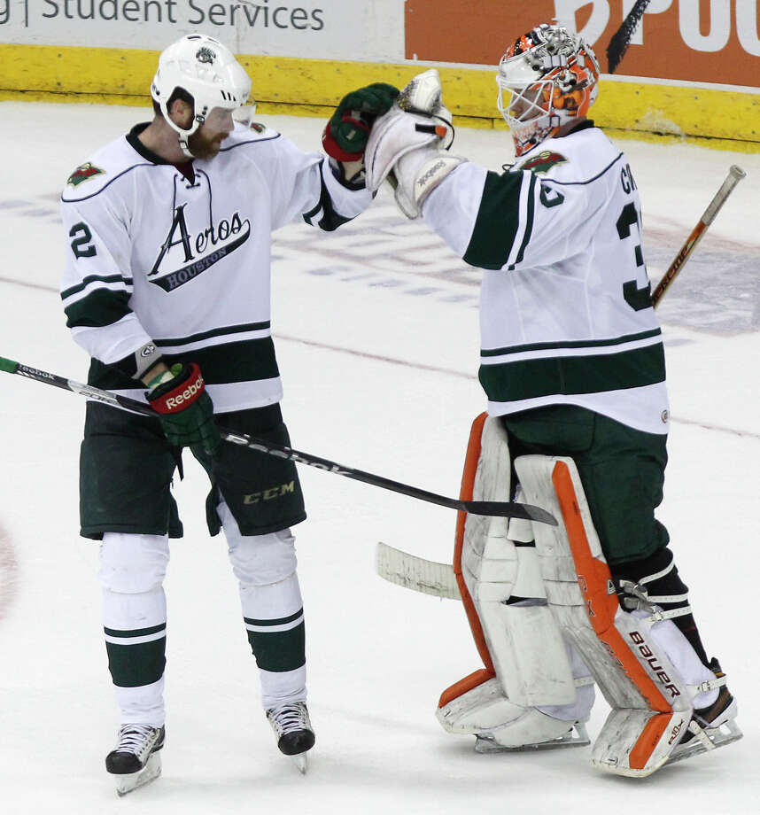 Houston Aeros defenseman Paul Mara, left, celebrates a 4-1 win over the San Antonio Rampage with goalie Mike Condon after their final regular-season game at the Toyota Center Saturday, April 13, 2013, in Houston. Photo: Cody Duty, Houston Chronicle / © 2013 Houston Chronicle