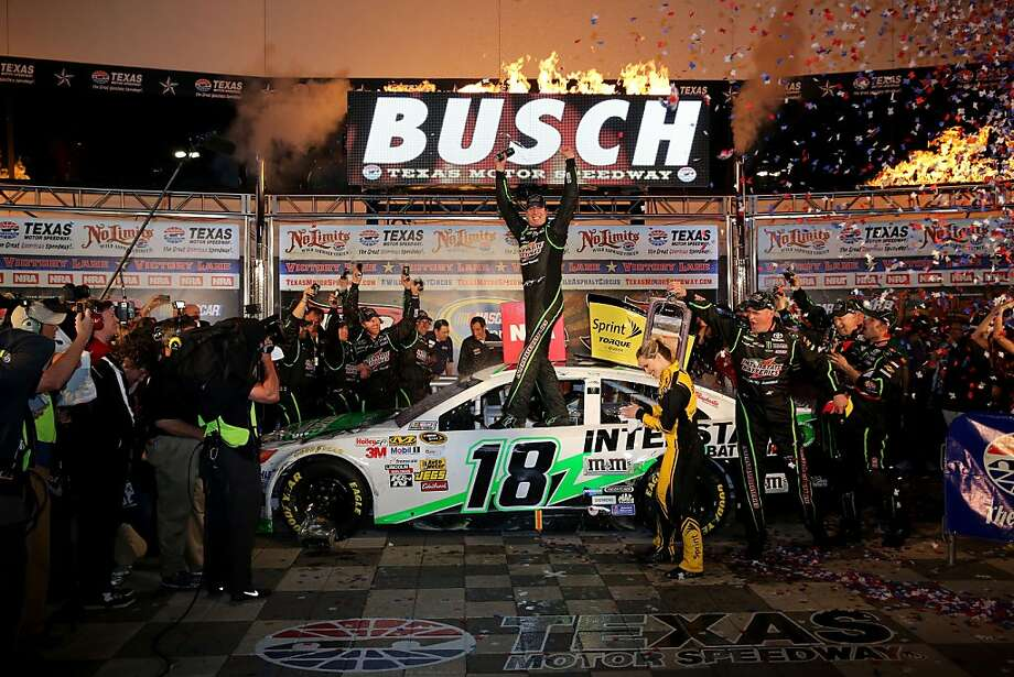 Kyle Busch stands after delivering his second race victory this weekend at Texas Motor Speedway, his 26th Sprint Cup win. Photo: Jerry Markland, (Credit Too Long, See Caption)