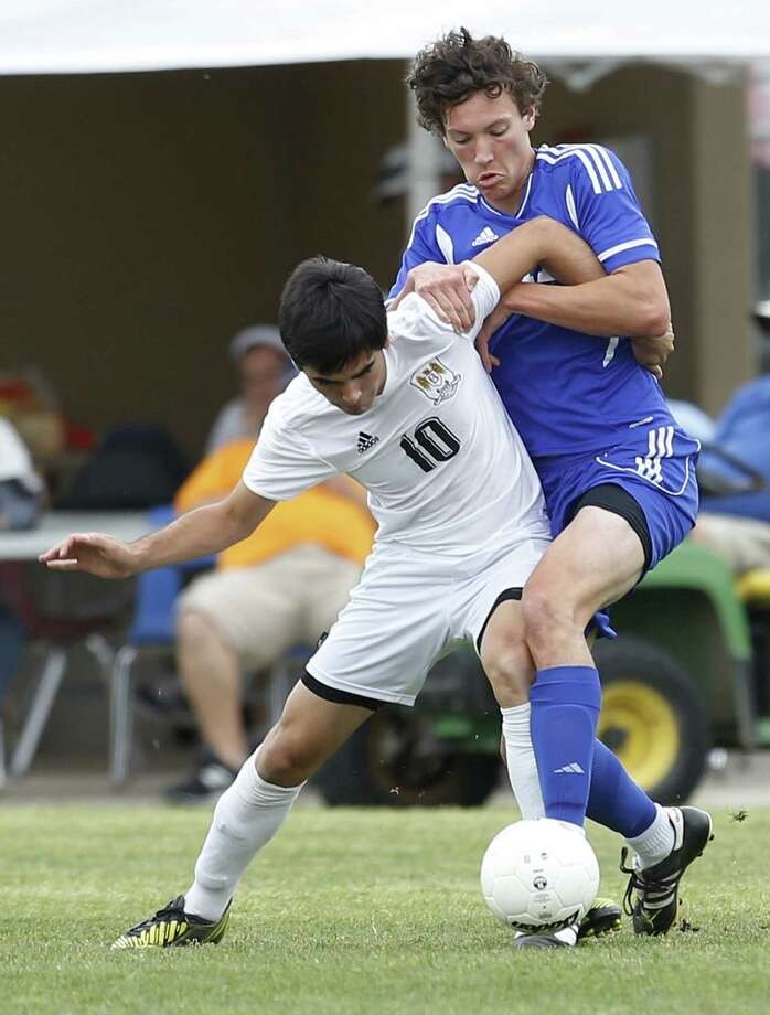 Carlos Acevedo (left) and Brownsville Hanna kept Zach Stockand and Jay at bay in the Region IV-5A boys final.