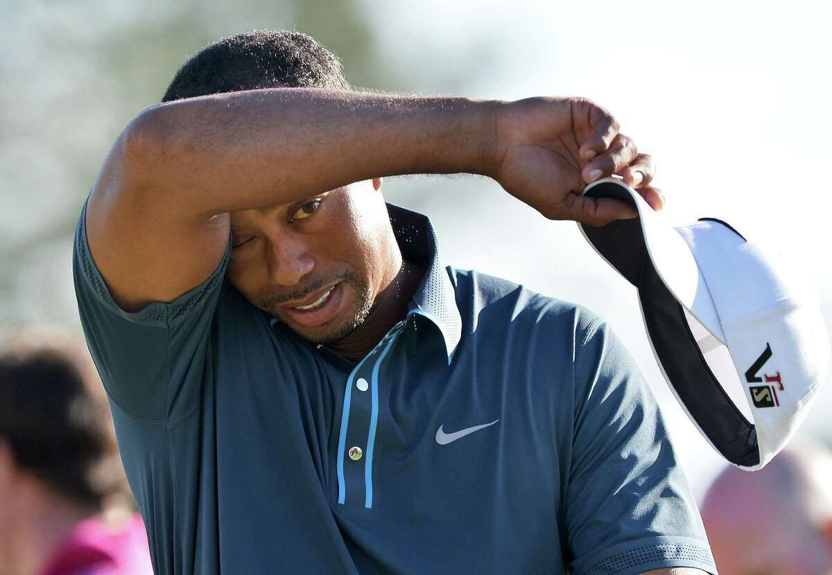 It was a long day for Tiger Woods on Saturday. It began with him being assessed a two-shot penalty for a second-round rules violation. It ended with his third-round 70 leaving him four shots behind the co-leaders.