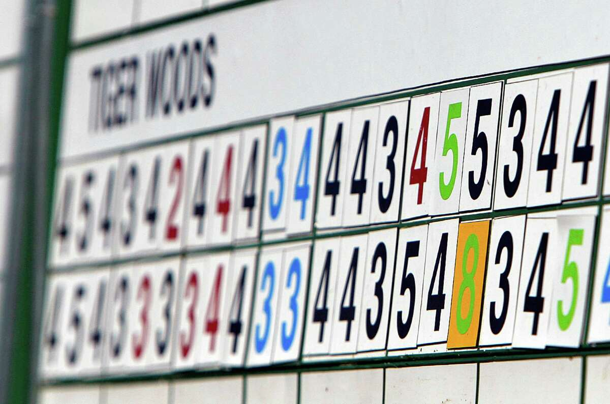 The scoreboard reflected a two-shot penalty on Tiger Woods for an infraction on No. 15 in Friday's round.