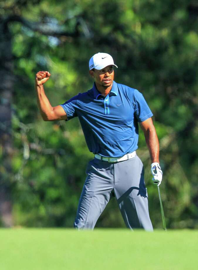 Tiger Woods likes his second shot on No. 15 during the third round of the Masters in Augusta, Ga. He's four shots back despite Saturday's two-shot penalty. Photo: Jeff Siner / McClatchy-Tribune News Service