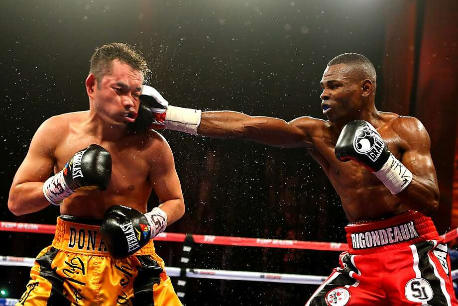 Guillermo Rigondeaux punches Nonito Donaire during their 122-pound unification title bout. Photo: Al Bello, Getty Images