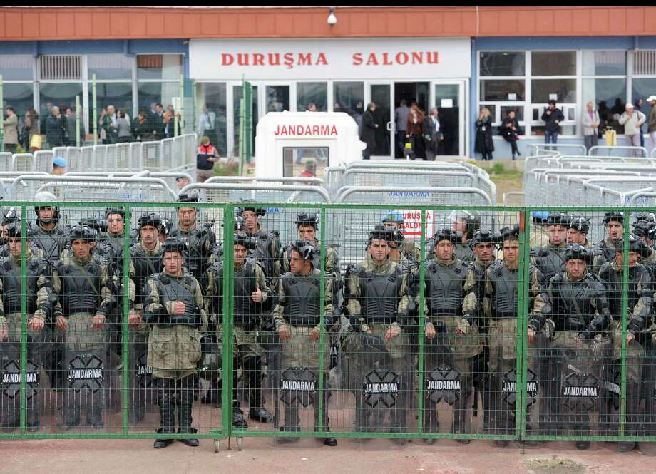 Military police stand in front of the courthouse as thousands of Turks clash with security as they try to break through barricades mounted around the prison and courthouse complex in Silivri, in the outskirts of Istanbul, Turkey, Monday, April 8, 2013. Riot police used water cannons, tear gas and pepper spray to disperse demonstrators gathered outside the courthouse in a show of solidarity with 275 people who are on trial accused of plotting to overthrow Prime Minister Recep Tayyip Erdogan's government. Photo: AP