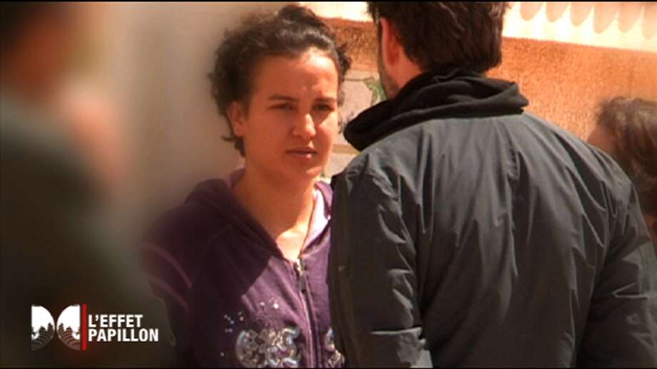 This recent image from video provided by CAPA and Canal+ television on Monday April, 8, 2013 shows Tunisian Femen activist Amina. Bewilderment, scorn, resentment - women's rights activists across the Middle East are reacting with everything but joy to topless demonstrations in Europe by the Ukrainian feminist group FEMEN against oppression of women in Muslim countries. They fear the bare breasts may hurt their cause more than help it, after FEMEN activists protested in front of mosques and Tunisian embassies last week in solidarity with a Amina who caused a scandal in her own country when she posted topless photos of herself protesting religious oppression. Photo: AP