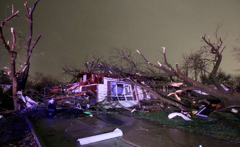 "A tree fell on a home on Lynn Haven Lane in Hazelwood, Missouri during a storm that caused extensive damage to homes and businesses on Wednesday, April 10, 2013. Butch Dye, a hydrometeorological technician with the National Weather Service in St. Louis, Mo., said severe weather struck the suburb of Hazelwood.  ""We won't be able to confirm whether it was a tornado until teams get out there tomorrow,"" Dye said. Photo: AP"