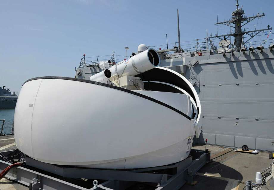 The Laser Weapon System (LaWS) temporarily installed aboard the guided-missile destroyer USS Dewey (DDG 105) in San Diego, Calif., in this July 2012 photo is a technology demonstrator built by the Naval Sea Systems Command from commercial fiber solid state lasers, utilizing combination methods developed at the Naval Research Laboratory. Navy leaders announced plans Monday April 8, 2013  to deploy for the first time a solid-state laser aboard the USS Ponce in fiscal year 2014. Photo: AP
