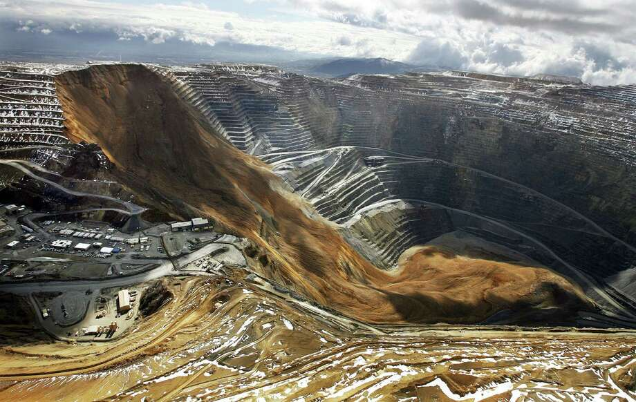 This photo shows the Kennecott Utah Copper Bingham Canyon Mine after a landslide Thursday, April 11, 2013 in Bingham Canyon, Utah. Kennecott Utah Copper has suspended mining inside one of the world's deepest open pits as geologists assess a landslide the company says it anticipated for months. (AP Photo/The Deseret News, Ravell Call)  Photo: AP