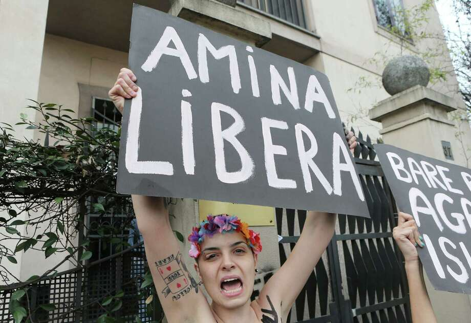 In this April 4, 2013 file photo, a FEMEN activist protest in front of the Tunisian Consulate in Milan, Thursday, April 4, 2013. The radical feminists, calling for more sexual freedom for Arab women, were protesting in support of a young Tunisian woman who received online death threats from ultraconservative Muslims after posting topless photos of herself online. Women's rights activists across the middle east fear the topless protests may hurt their cause more than help it. Photo: AP