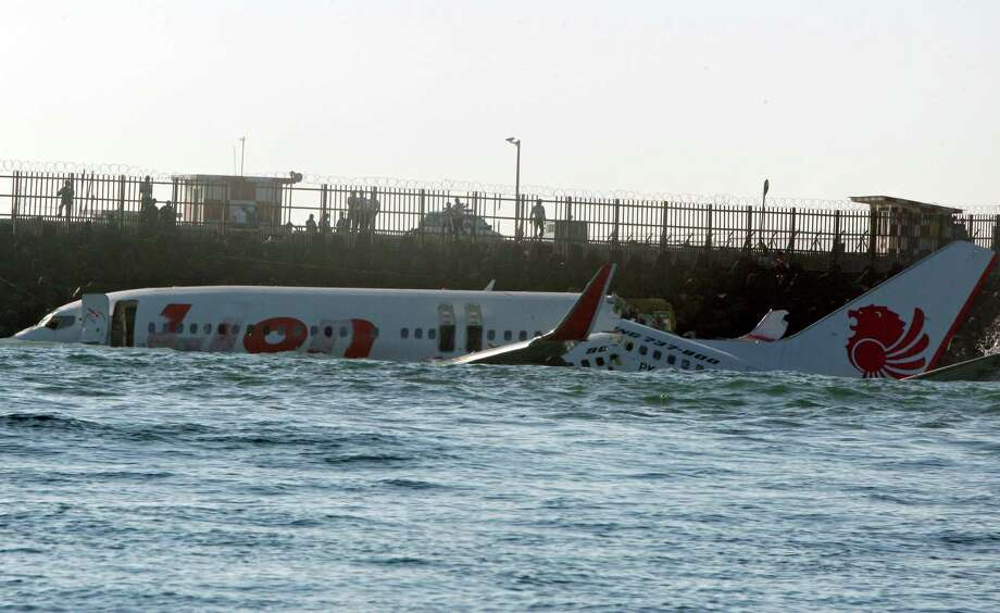 The wreckage of a Lion Air jet sits in the ocean near the airport in Bali, Indonesia on Sunday, April 14, 2013. All 108 passengers and crew survived after the new Lion Air jet crashed into the ocean and snapped into two while attempting to land Saturday on the Indonesian resort island of Bali, injuring up to 45 people. Photo: AP