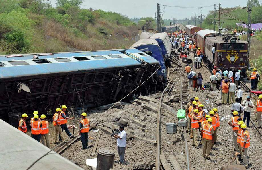 Indian rescue workers gather at the site of a train accident near in Sitheri near Arakkonam, India, Wednesday, April 10, 2013. A passenger train traveling through southern Indian derailed at Sitheri, about 90 kilometers (56 miles) southwest of Chennai early Wednesday morning, killing one person and injuring dozens more, according to local reports. Photo: AP