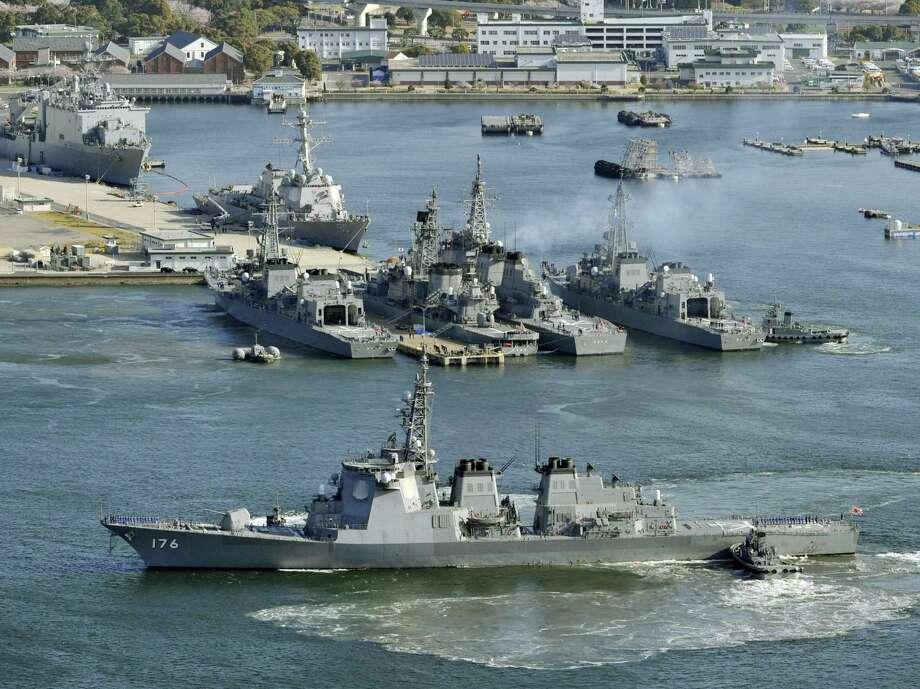 CORRECTS DATE IN SECOND SENTENCE - FILE - In this Saturday, April  7, 2012 file photo, Japan Maritime Self-Defense Force Aegis destroyer Chokai, foreground, departs Sasebo naval base, western Japan, in preparation for North Korea's rocket launch, expected to take place mid April, 2012. Amid reports North Korea is preparing a missile launch or another nuclear test, Japan on Tuesday, April 9, 2013 deployed PAC-3 missile interceptors in key locations around Tokyo. Japan's defense minister has also reportedly put destroyers with missile interception systems on alert in the Sea of Japan. (AP Photo/Kyodo News, File) Photo: AP