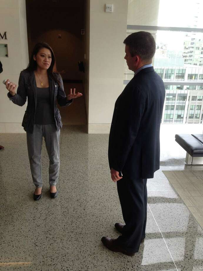 Actress Junie Hoang, left, speaks with her lawyer, Derek Newman, outside a federal courtroom in Seattle on Thursday, April 11, 2013, after a jury rejected her breach-of-contract claim against the Internet Movie Database for revealing her age. IMDb argued that it has a First Amendment right to publish accurate information and Hoang can't prove she lost any money because of it. Photo: AP