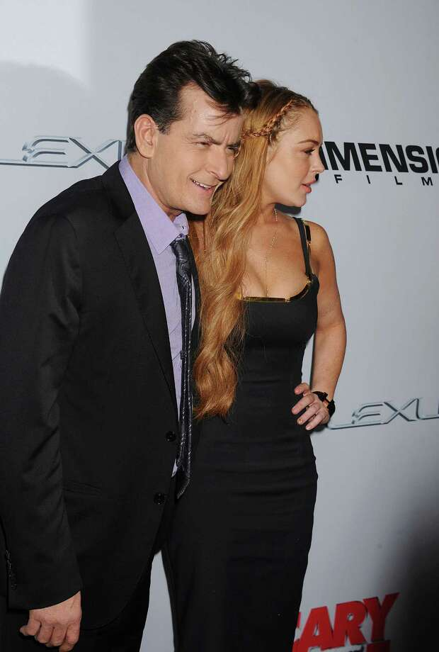 Actors Charlie Sheen and Lindsay Lohan arrive at the 'Scary Movie V' Los Angeles premiere atArcLight Cinemas Cinerama Dome on April 11, 2013 in Hollywood, California. (Photo by Jeffrey Mayer/WireImage) Photo: Jeffrey Mayer, Getty / 2013 Jeffrey Mayer