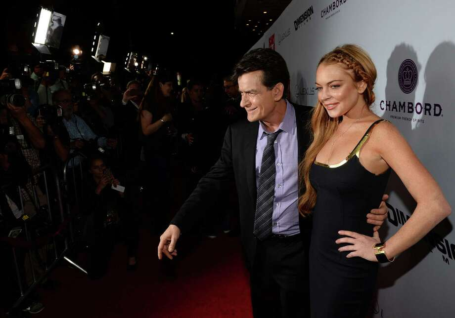 "Actors Charlie Sheen and Lindsay Lohan arrive for the premiere of Dimension Films' ""Scary Movie 5"" at ArcLight Cinemas Cinerama Dome on April 11, 2013 in Hollywood, California. Photo: Michael Buckner, Getty / 2013 Getty Images"