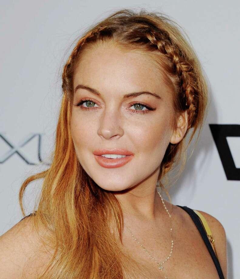 "Actress Lindsay Lohan arrives at the Los Angeles Premiere ""Scary Movie V"" at ArcLight Cinemas Cinerama Dome on April 11, 2013 in Hollywood, California.  (Photo by Jon Kopaloff/FilmMagic) Photo: Jon Kopaloff, Getty / 2013 Jon Kopaloff"