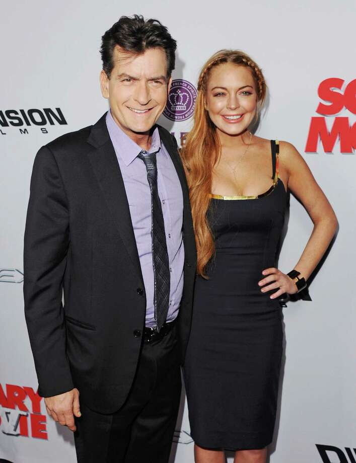 "Actor Charlie Sheen and actress Lindsay Lohan arrive at the Los Angeles Premiere ""Scary Movie V"" at ArcLight Cinemas Cinerama Dome on April 11, 2013 in Hollywood, California.  (Photo by Jon Kopaloff/FilmMagic) Photo: Jon Kopaloff, Getty / 2013 Jon Kopaloff"