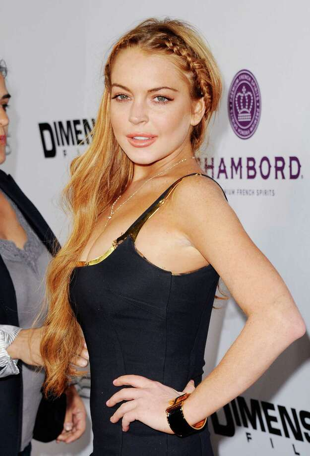 "Actress Lindsay Lohan arrives at the Los Angeles Premiere ""Scary Movie V"" at ArcLight Cinemas Cinerama Dome on April 11, 2013 in Hollywood, California.  (Photo by Jon Kopaloff/FilmMagic) Photo: Jon Kopaloff, Getty / 2013 Jon Kopaloff"