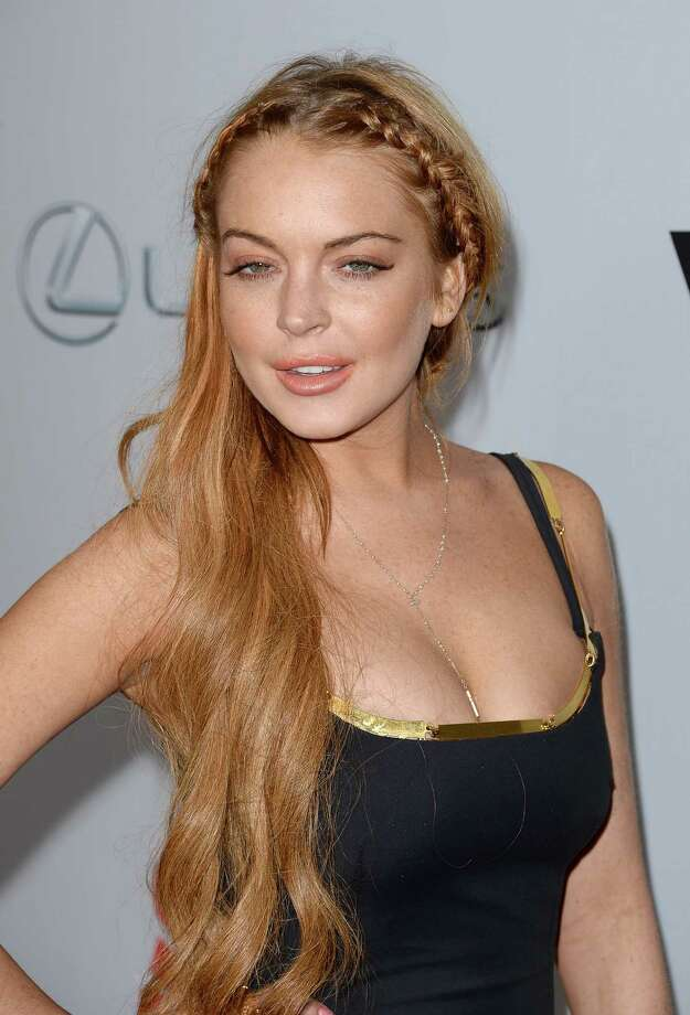 Actress Lindsay Lohan arrives at the Dimension Films' 'Scary Movie 5' premiere at the ArcLight Cinemas Cinerama Dome on April 11, 2013 in Hollywood, California. Photo: Jason Merritt, Getty / 2013 Getty Images
