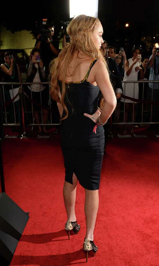 "Actress Lindsay Lohan arrives for the premiere of Dimension Films' ""Scary Movie 5"" at ArcLight Cinemas Cinerama Dome on April 11, 2013 in Hollywood, California. Photo: Michael Buckner, Getty / 2013 Getty Images"