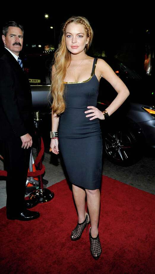 "Actress Lindsay Lohan arrives at the premiere of ""Scary Movie V"" presented by Dimension Films, in partnership with Lexus and Chambord at the Cinerama Dome on April 11, 2013 in Los Angeles, California.  (Photo by John Sciulli/WireImage) Photo: John Sciulli, Getty / 2013 WireImage"
