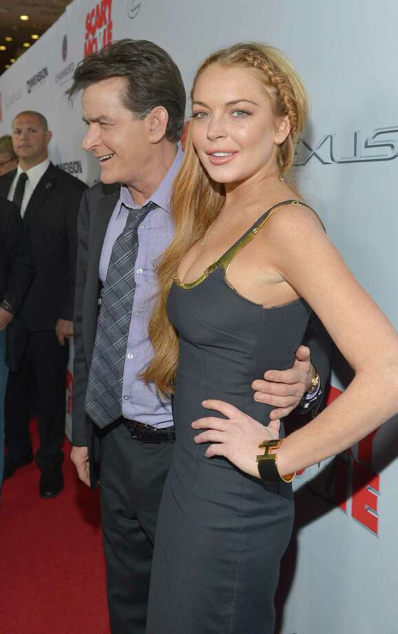 "Actors Charlie Sheen (L) and Lindsay Lohan arrive at the premiere of ""Scary Movie V"" presented by Dimension Films, in partnership with Lexus and Chambord at the Cinerama Dome on April 11, 2013 in Los Angeles, California.  (Photo by Charley Gallay/WireImage) Photo: Charley Gallay, Getty / 2013 WireImage"