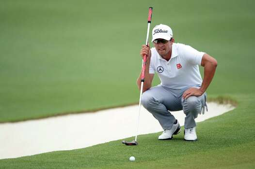 AUGUSTA, GA - APRIL 14:  Adam Scott of Australia lines up a putt on the second hole during the final round of the 2013 Masters Tournament at Augusta National Golf Club on April 14, 2013 in Augusta, Georgia. Photo: Harry How, Getty Images / 2013 Getty Images