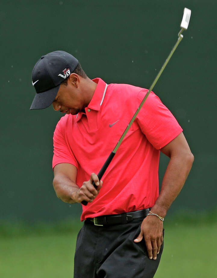 Tiger Woods swings his putter after his bogey on the fifth hole during the fourth round of the Masters golf tournament Sunday, April 14, 2013, in Augusta, Ga. (AP Photo/Charlie Riedel) Photo: Charlie Riedel, Associated Press / AP