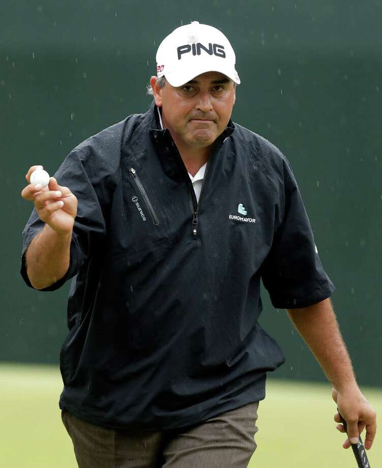 Angel Cabrera, of Argentina, holds up his ball after making par on the fifth hole during the fourth round of the Masters golf tournament Sunday, April 14, 2013, in Augusta, Ga. (AP Photo/Charlie Riedel) Photo: Charlie Riedel, Associated Press / AP