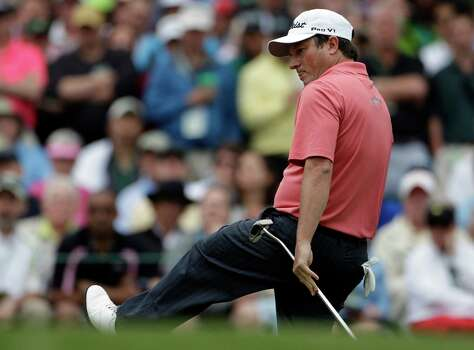 Tim Clark, of South Africa, reacts after missing a putt on the third green during the fourth round of the Masters golf tournament Sunday, April 14, 2013, in Augusta, Ga. (AP Photo/Darron Cummings) Photo: Darron Cummings, Associated Press / AP