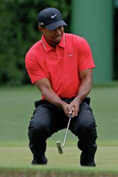 Tiger Woods reacts after missing a putt on the fourth green during the fourth round of the Masters golf tournament Sunday, April 14, 2013, in Augusta, Ga. (AP Photo/Darron Cummings) Photo: Darron Cummings, Associated Press / AP
