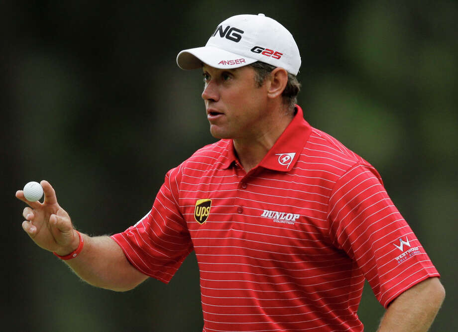 Lee Westwood, of England holds up his ball after making par on the third hole during the fourth round of the Masters golf tournament Sunday, April 14, 2013, in Augusta, Ga. (AP Photo/Matt Slocum) Photo: Matt Slocum, Associated Press / AP