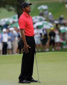 Tiger Woods reacts after missing a par putt on the seventh green during the fourth round of the Masters golf tournament Sunday, April 14, 2013, in Augusta, Ga. (AP Photo/David J. Phillip) Photo: David J. Phillip, Associated Press / AP