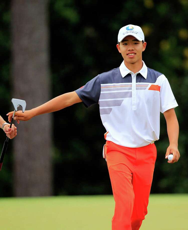 Tianlang Guan, 14 years old, comes off the 14th green during the final round of The Masters at Augusta National Golf Club in Augusta, Georgia, Sunday, April 14, 2013. (Tim Dominick/The State/MCT) Photo: TIM DOMINICK, McClatchy-Tribune News Service / The State