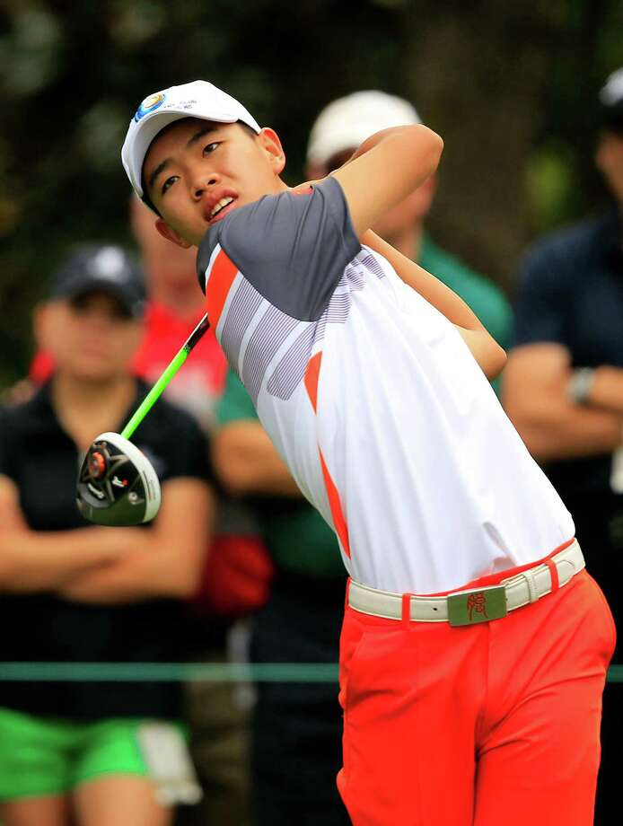 Tianlang Guan, 14 years old, tees off on the 15th hole during the final round of The Masters at Augusta National Golf Club in Augusta, Georgia, Sunday, April 14, 2013. (Tim Dominick/The State/MCT) Photo: TIM DOMINICK, McClatchy-Tribune News Service / The State