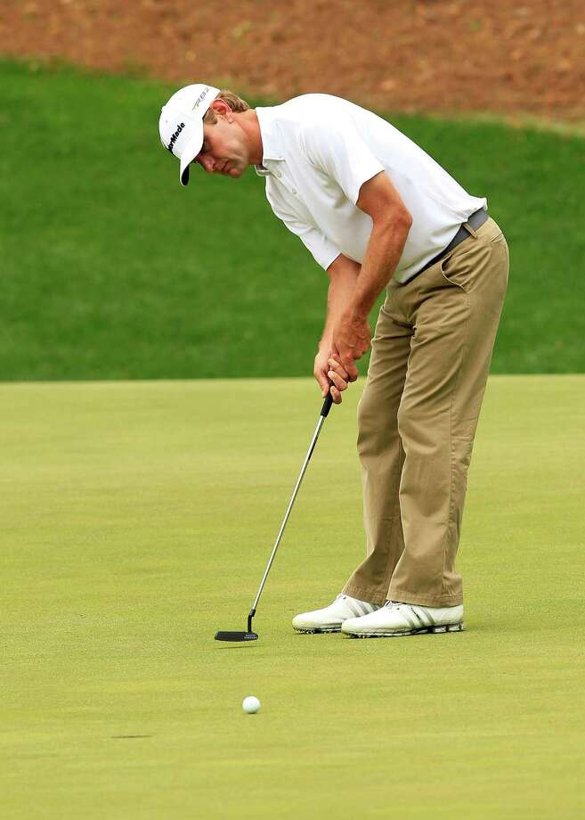 Lucas Glover putts for an eagle on the 13th green during the final round of The Masters at Augusta National Golf Club in Augusta, Georgia, Sunday, April 14, 2013. (Tim Dominick/The State/MCT) Photo: TIM DOMINICK, McClatchy-Tribune News Service / The State