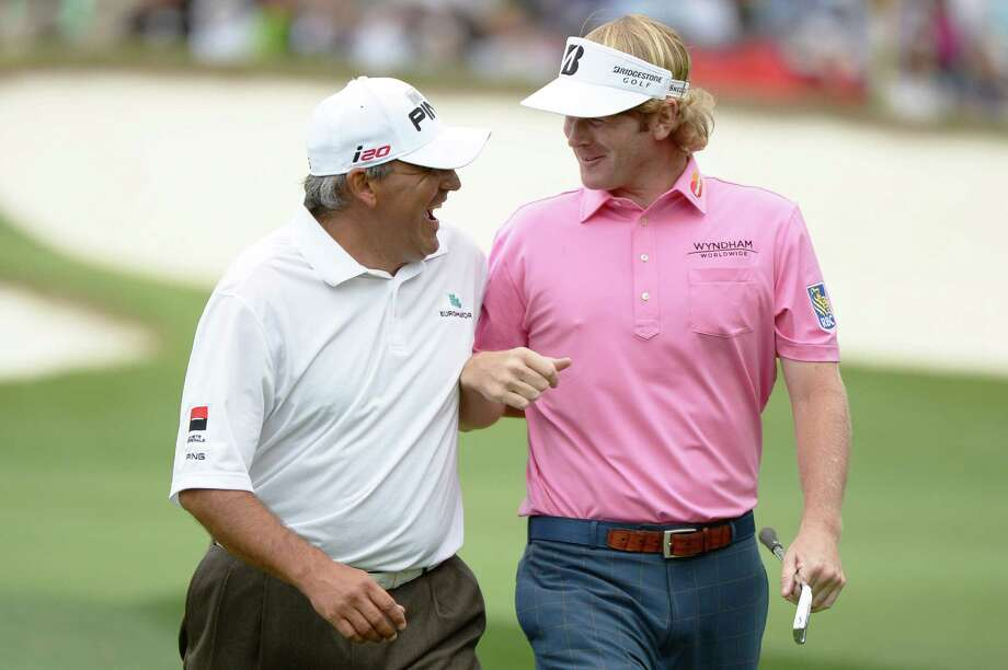AUGUSTA, GA - APRIL 14:  Angel Cabrera of Argentina and Brandt Snedeker of the United States talk on the second hole during the final round of the 2013 Masters Tournament at Augusta National Golf Club on April 14, 2013 in Augusta, Georgia. Photo: Harry How, Getty Images / 2013 Getty Images