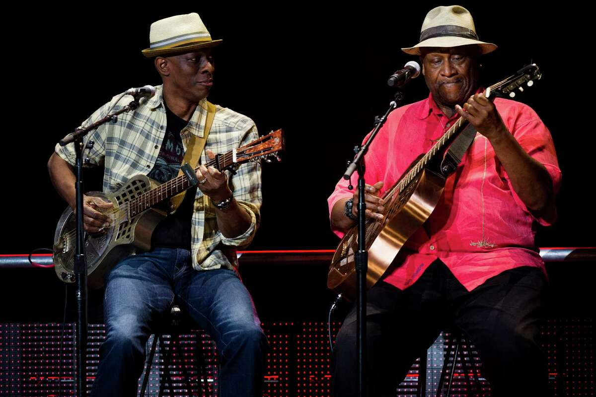 Keb Mo, left, and Taj Mahal perform at Eric Clapton's Crossroads Guitar Festival 2013 at Madison Square Garden on Saturday, April 13, 2013, in New York. (Photo by Charles Sykes/Invision/AP)