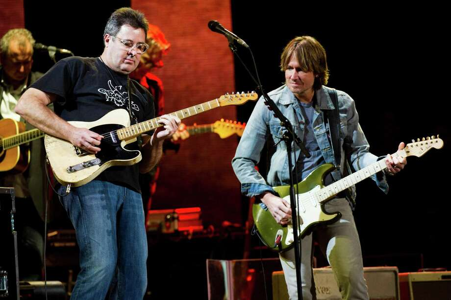 Vince Gill, left, and Keith Urban perform at Eric Clapton's Crossroads Guitar Festival 2013 at Madison Square Garden on Saturday, April 13, 2013, in New York. (Photo by Charles Sykes/Invision/AP) Photo: Charles Sykes