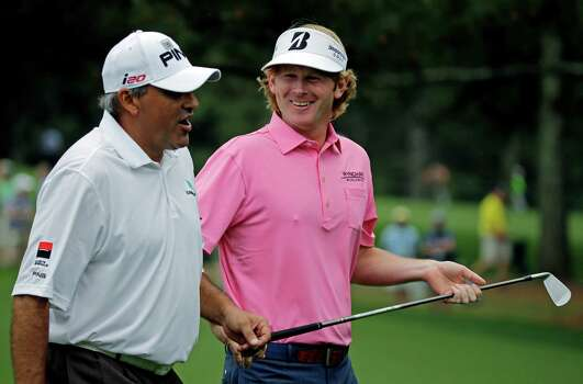 Brandt Snedeker, right, chats with Angel Cabrera, of Argentina, as they walk down the second fairway during the fourth round of the Masters golf tournament Sunday, April 14, 2013, in Augusta, Ga. (AP Photo/David J. Phillip) Photo: David J. Phillip, Associated Press / AP