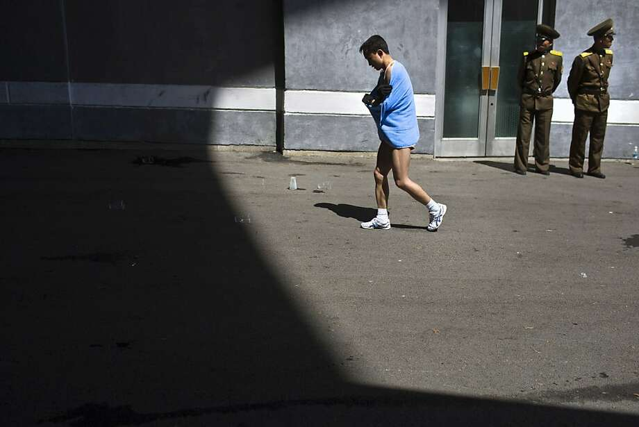 A marathon runner walks out of Kim Il Sung Stadium after completing the race in Pyongyang on Sunday, April 14, 2013. North Korea hosted the 26th Mangyongdae Prize Marathon to mark the upcoming April 15, 2013 birthday of the late leader Kim Il Sung. (AP Photo/David Guttenfelder) Photo: David Guttenfelder, Associated Press